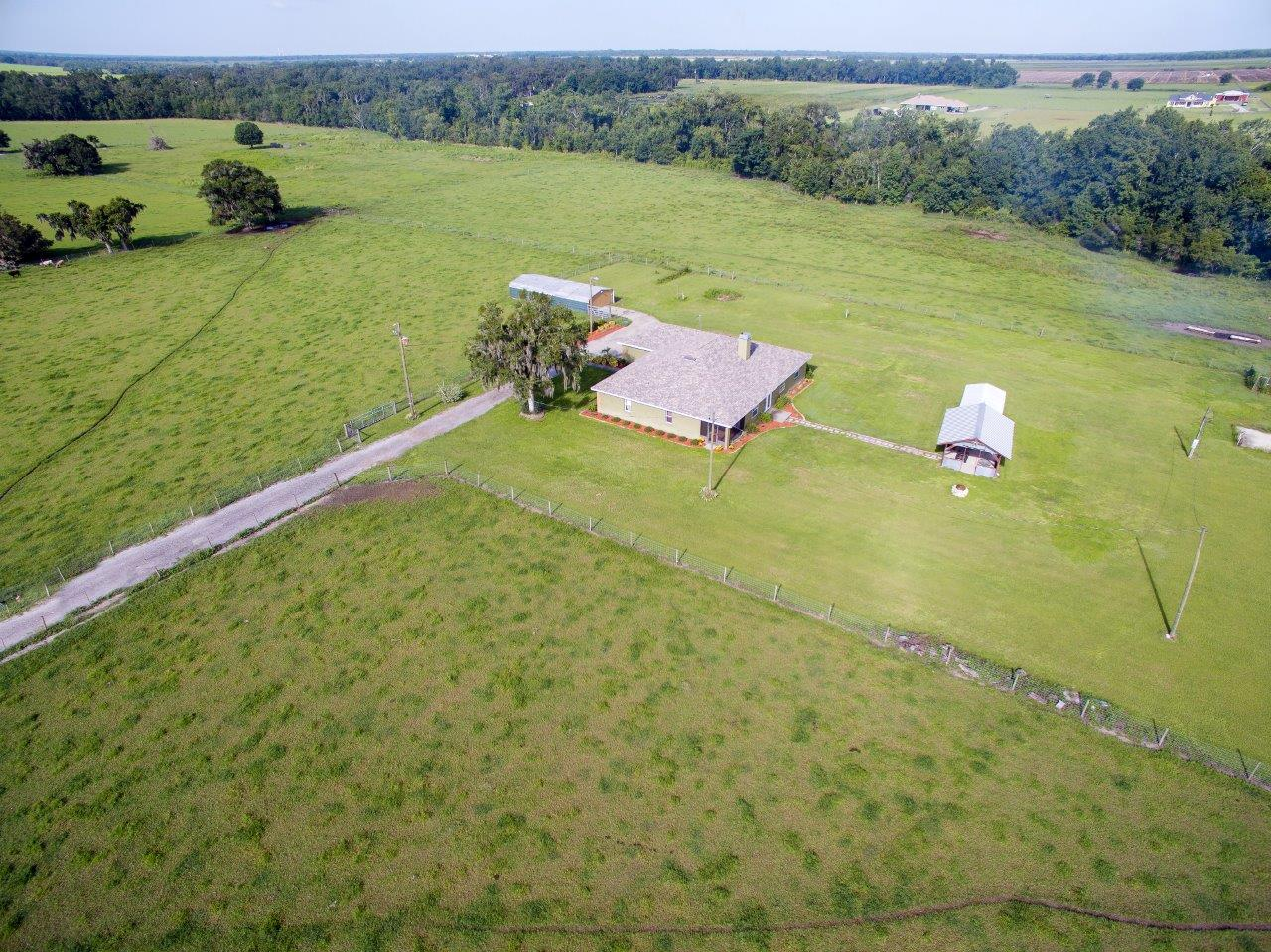 Carlton Lake Road Home with 21 Acres in Wimauma, FL